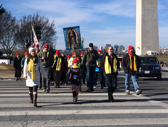 ABOVE: A group of marchers from St. Stephen of Hungary Parish in Allentown, Pennsylvania, on Jan. 19, 2018, near the Washington Monument. Photo by Maryann Schwartz. BELOW: (1) Angelo Evans from Greensboro, North Carolina. (2) Nicholas Hiles from Gaithersburg, Maryland. Photos by Susie Lloyd.