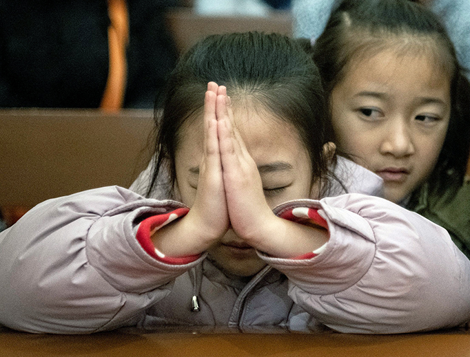 Children attend Christmas Eve Mass in Beijing on Dec. 24, 2019.