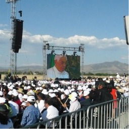 People view Pope Benedict XVI's speech on large screen at the airport of Guanajuato.