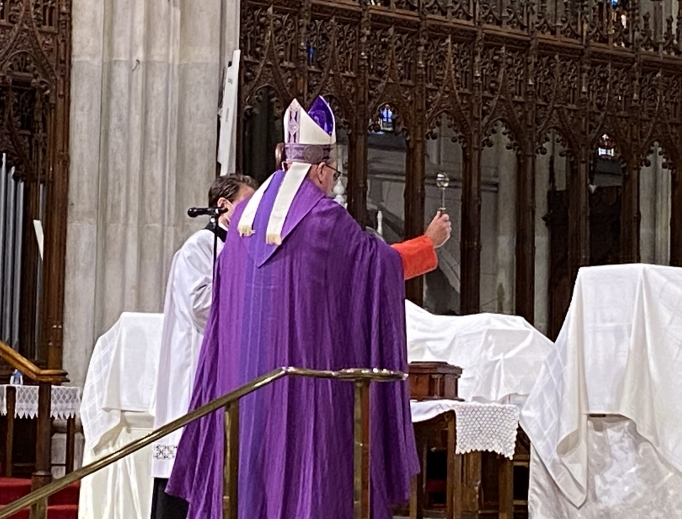 Cardinal Dolan blesses the remains of immigrants who died of coronavirus inside St. Patrick's Cathedral in Manhattan on July 11, 2020.