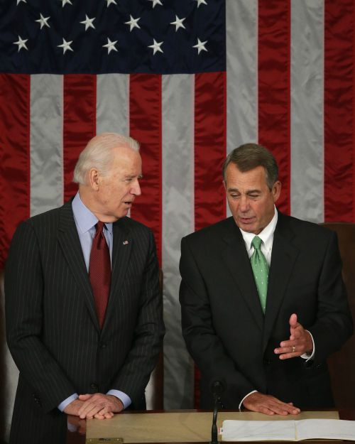Vice President Joe Biden (l) and Speaker of the House John Boehner talk in the House Chamber at the U.S. Capitol on March 25.