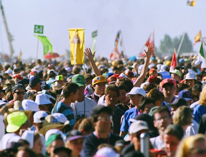An estimated 750,000 youth descended on Cherry Creek State Park in August 1993, as shown in archival photos that include Pope St. John Paul II celebrating the closing Mass. The 25th anniversary was celebrated Aug. 11 in Denver (below). Archbishop Samuel Aquila is showing celebrating the anniversary Mass with priests from the Archdiocese of Denver.