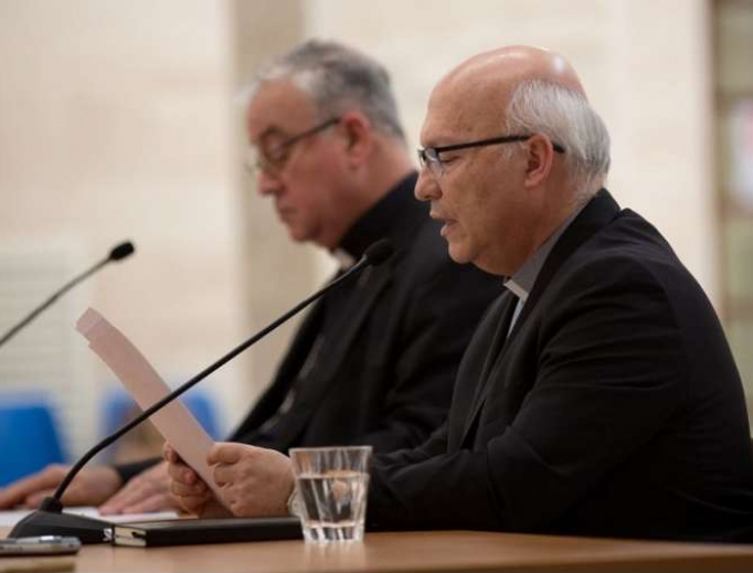 Bishop Fernando Ramos of Chile reads a statement to the press May 18.
