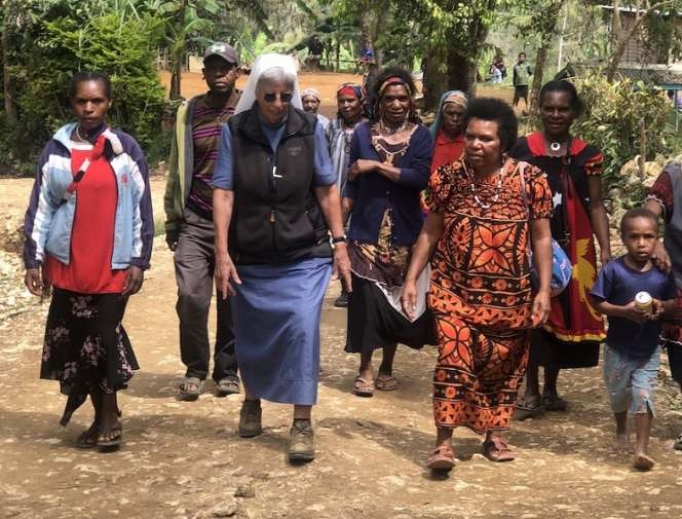 Sr. Lorena Jenal walks with local people from the Diocese of Mendi in Papua New Guinea.