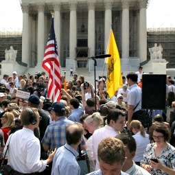 Opponents and proponents of President Obama's health-care package await the Supreme Court's ruling outside the U.S. Supreme Court building June 28 in Washington.