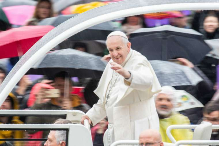 Pope Francis waves at the general audience, April 10, 2019.