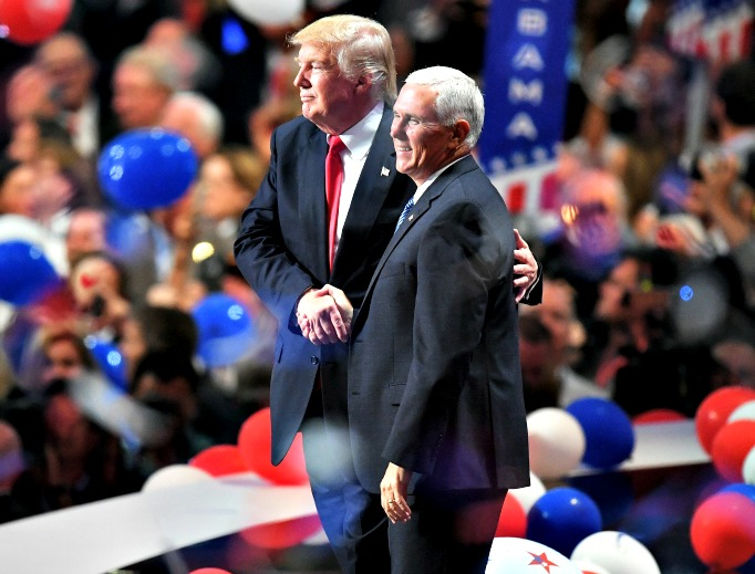 Republican presidential candidate Donald Trump (left) and Republican vice presidential candidate Mike Pence acknowledge the crowd at the end of the Republican National Convention on July 21 at the Quicken Loans Arena in Cleveland.
