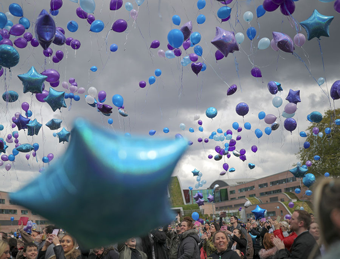 People react as balloons are released in memory of Alfie Evans outside Alder Hey Hospital after the 23-month-old boy died at 2:30 a.m. on April 28, 2018, in Liverpool, England.