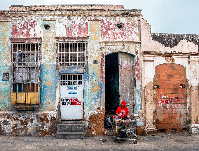 Graffiti praising socialist dictator Hugo Chávez is seen on a house in Maracaibo, Venezuela. The International Monetary Fund projects that Venezuela's inflation rate will hit 1,000,000 percent in 2018.