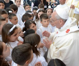 Pope Francis meets with first Communicants May 26 at Sts. Elizabeth and Zechariah parish in Rome.