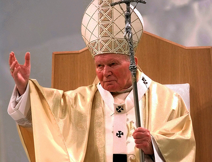 Pope St. John Paul II, who in 1982 founded the theological institute that is now named for him, gestures to the crowd during Mass in St. Louis, Missouri, Jan. 27, 1999.