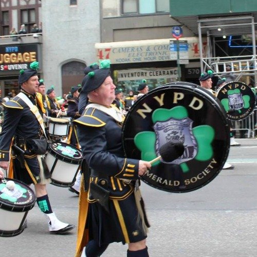 The  NYPD Emerald Society Pipe & Drum Band marches in the 2014 New York City St. Patrick's Day Parade.