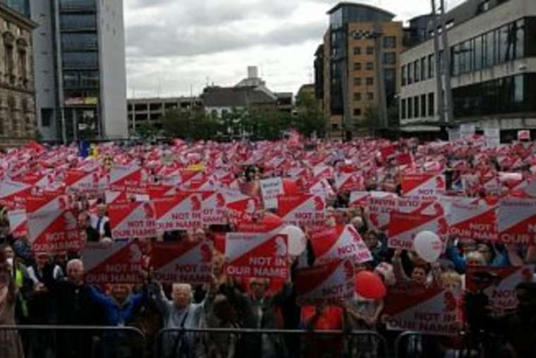 Protesters attend the 'March for Their Lives' rally in Belfast Sept. 7.