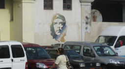 Signs of the revolution, including this image of Che Guevara, still dominate in Cuba, a place where faithful Catholics have held on for the past 50 years.