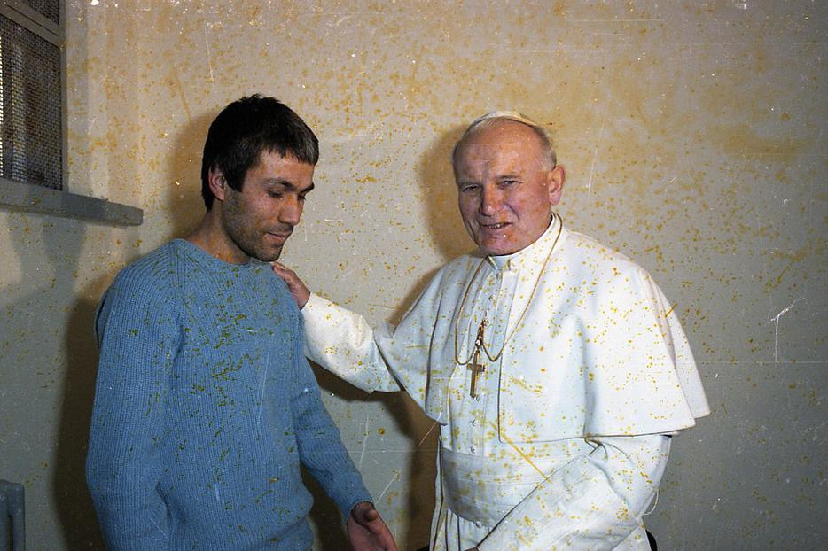 Scan of a rare image of Pope John Paul II meeting his would-be assassin, Mehmet Ali Agca, in a Rome prison Dec. 27, 1983.