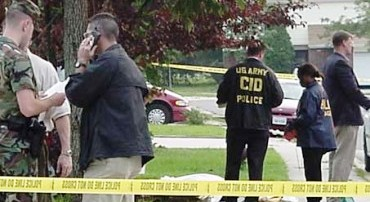 Investigators at the crime scene in Wichita, Kan., where late-term abortionist George Tiller was murdered May 31.