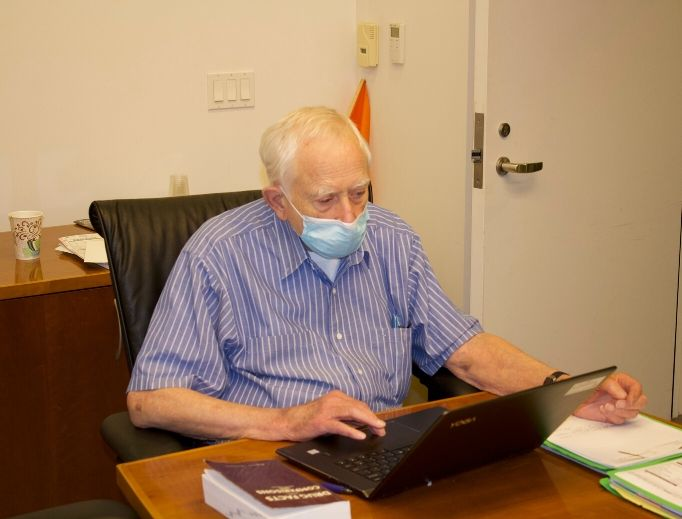 Dr. Thomas Wallace conducts a telemedicine call at the Order of Malta Clinic in Oakland, California.