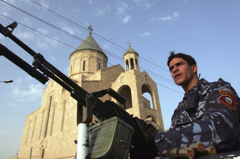 Policeman stands guard outside Our Lady of Flower Catholic Church in central Baghdad.