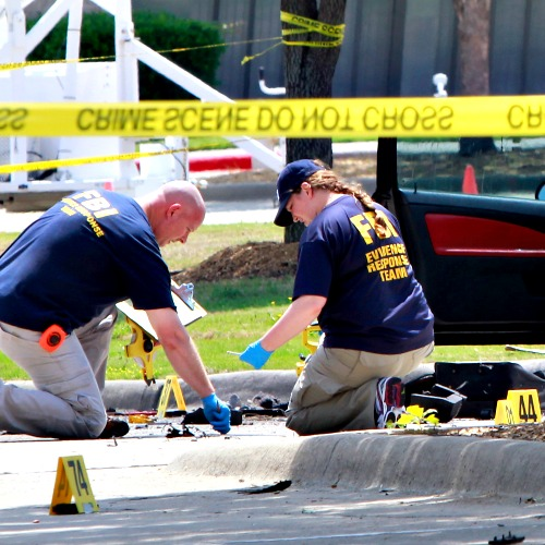 Investigators work a crime scene outside of the Curtis Culwell Center after a shooting occurred the day before May 4 in Garland, Texas.
