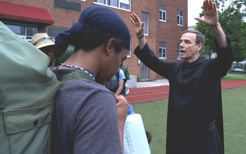 BLESSED BY A MONK. Students receive a blessing by a Benedictine monk at St. Benedict's Prep in Newark, N.J.