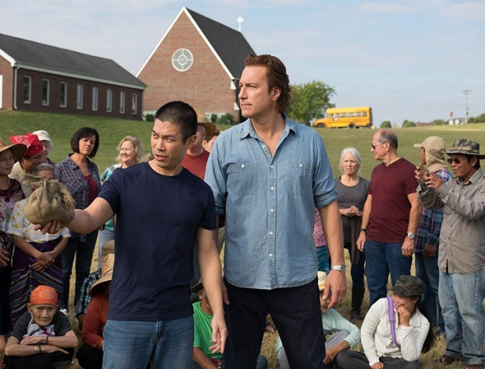 Ye Win (Nelson Lee) and Rev. Michael Spurlock (John Corbett) work together for the good of community and faith.