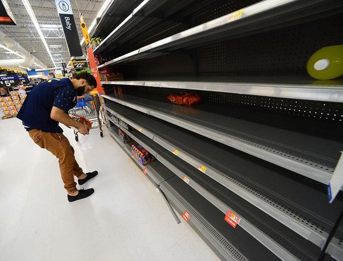 A Walmart employee stocks Gatorade on an empty shelf on August 29, 2019 in Orlando, Florida. People throughout the Bahamas, Florida, Georgia and the Carolinas are preparing for Hurricane Dorian to hit beginning Sunday.
