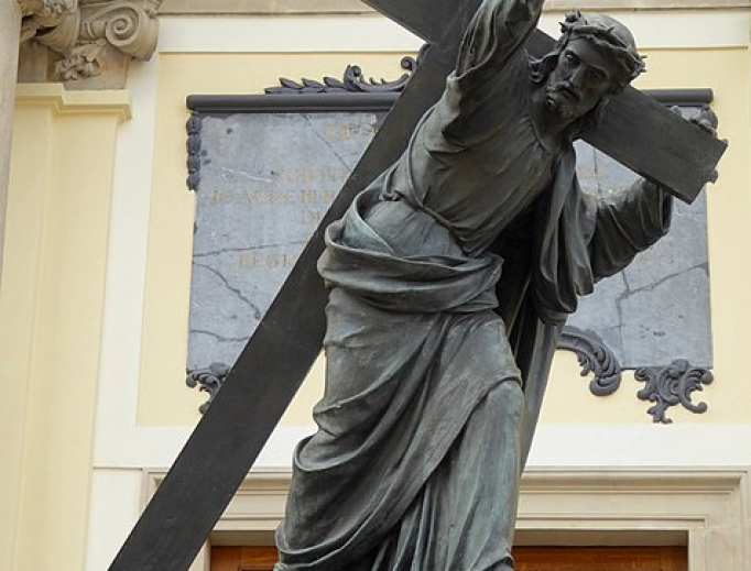 Statue of Christ carrying the cross at the front of the Holy Cross Church in Warsaw.