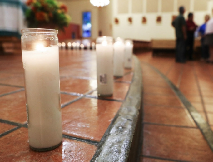 Candles honoring the 20 deceased victims of the El Paso mass shooting sit in St. Pius X Church Aug. 3 following a vigil for victims in El Paso, Texas. At least 26 people were wounded.