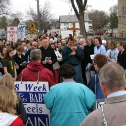 A priest leads pro-lifers in prayer outside the Northern Illinois Women's Center in 2010.