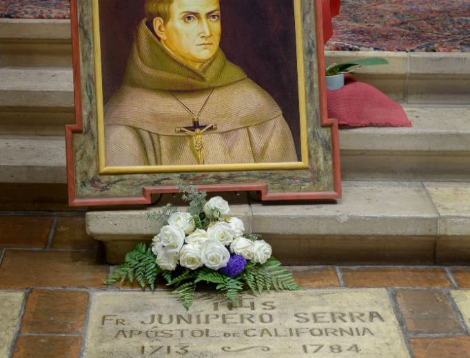 The grave of St. Junípero Serra, 'Apostle of California,' is located near the altar of the Carmel Mission in Carmel-by-the-Sea, California.