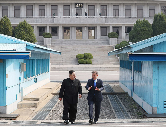 Kim Jong-un walks with President Moon Jae-in in the Joint Security Area between North and South Korea on April 27, 2018
