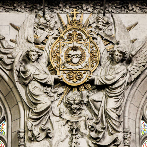 The Sacred Heart held aloft by two angels is in the Church of the Sacré Coeur in Lille, France.