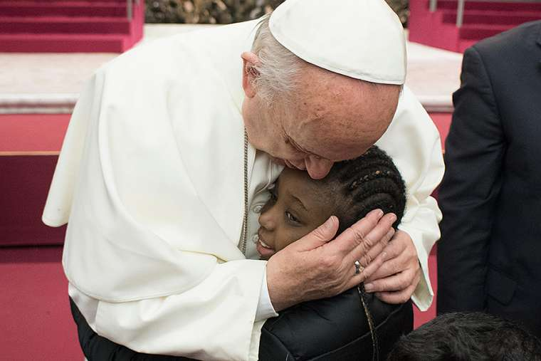Pope Francis hosts a pizza party for sick children in Vatican City on Dec. 17, 2017.