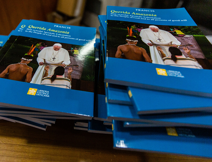 Copies of the apostolic exhortation 'Querida Amazonia' await distribution at the press conference for the presentation of the post-synodal document at the Vatican Press Office on Feb. 12.
