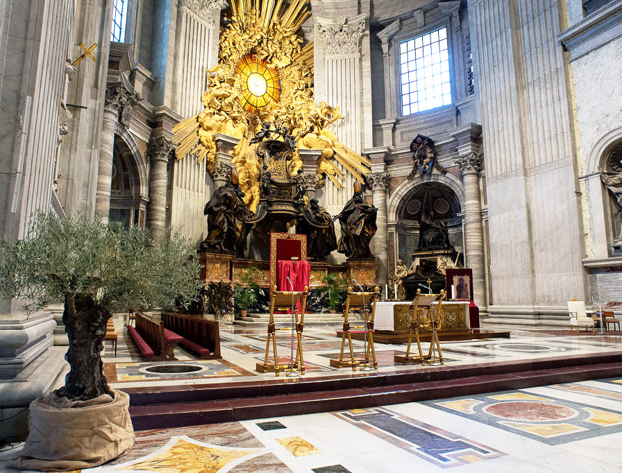A view of the main altar of St. Peter's Basilica prepared for the Palm Sunday vigil on April 4, 2020, in Vatican City. Pope Francis will celebrate the Palm Sunday Mass in an empty basilica. Yesterday the Pontiff sent a video message as Christians around the world prepare to celebrate Holy Week in an unusual manner due to the COVID-19 coronavirus pandemic.