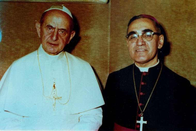 Pope Paul VI and Archbishop Oscar Romero pose together in an undated file photo.
