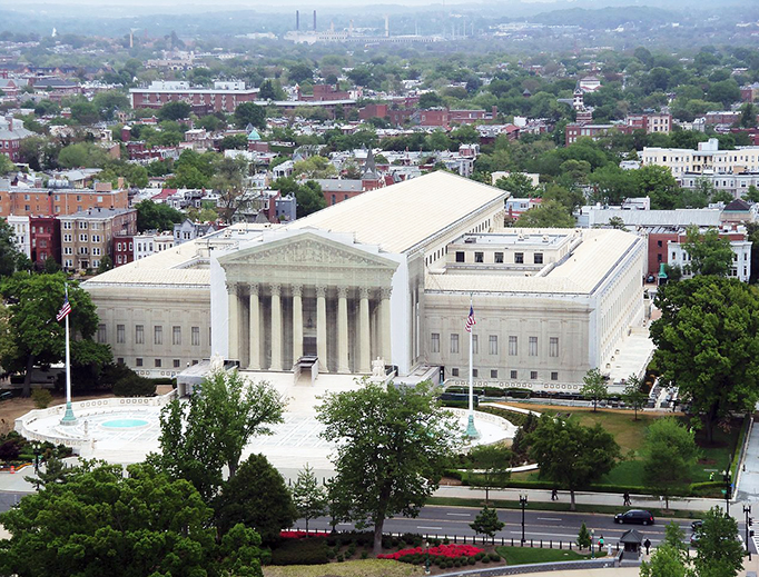 The Supreme Court Building of the United States from the dome of the capitol building. The facade is covered during renovation.