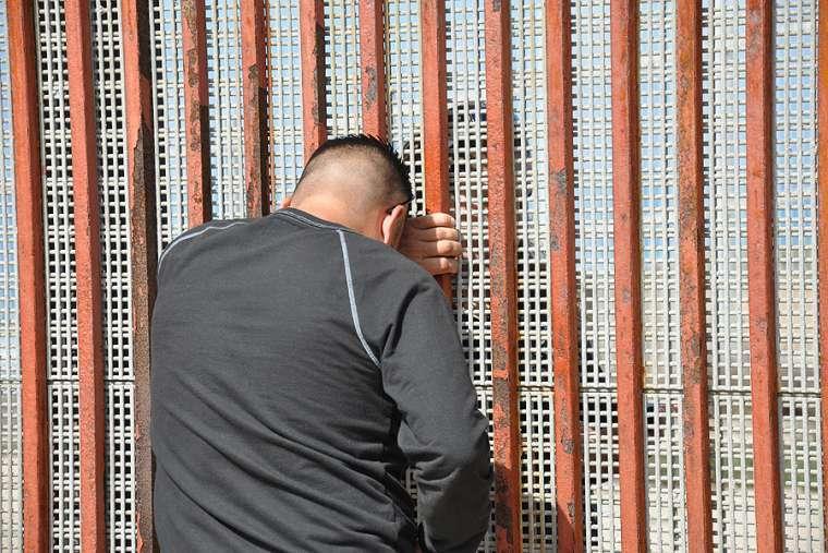 Families meet through a border fence