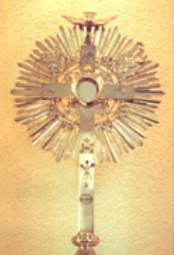 The Eucharist exposed in a monstrance.