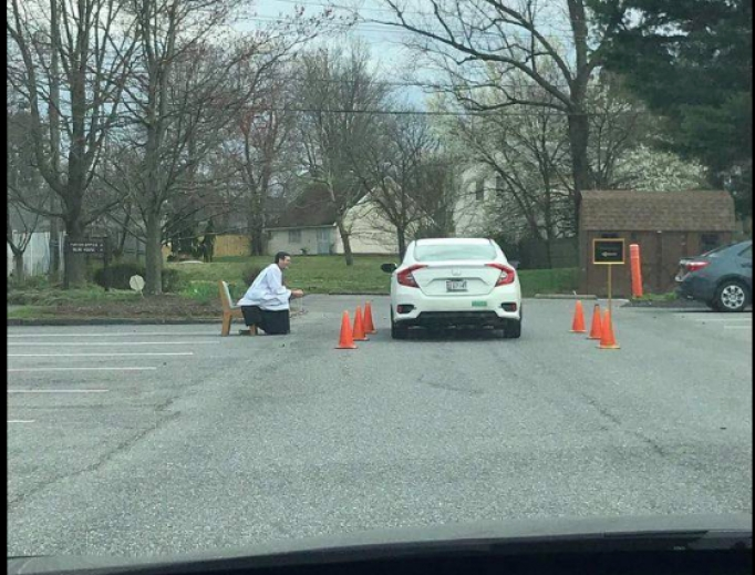 Father Scott Holmer offering a drive-thru confession at St. Edward the Confessor in Bowie, Maryland.