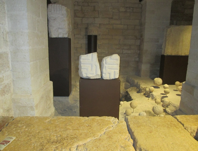 Hailed as the world's first museum to focus on the roots of Christianity, Jerusalem's Terra Sancta Museum is housed in the Monastery of the Flagellation. It stands beside the site of the ancient Antonia Tower built by King Herod and features artifacts dating back 2,000 years (shown above and below). Below, Franciscan Eugenio Alliata, director of the Archaeological Museum-Stadium Biblicum Franciscanum, which overseas the ancient artifacts in the Terra Sancta Museum, believes Christian pilgrims can benefit greatly from visiting the museum before retracing Jesus' steps on the Via Dolorosa.
