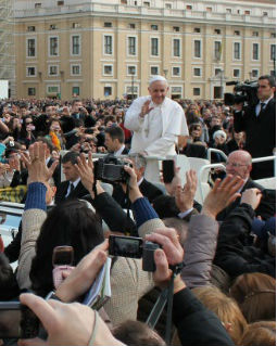 Pope Francis makes his way through St. Peter's Square during his April 3 general audience.