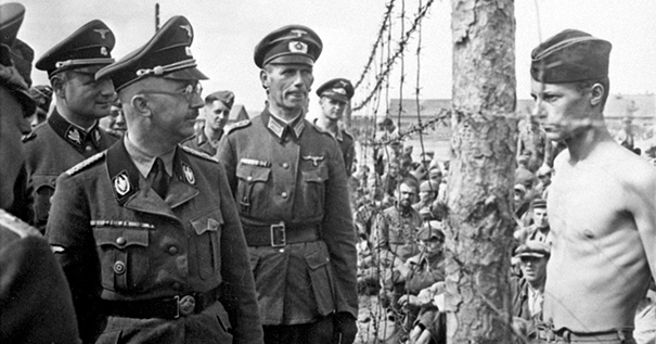 An unnamed prisoner of war confronts Heinrich Himmler at Shirokaya Street POW Camp in Minsk, USSR, August 1941.