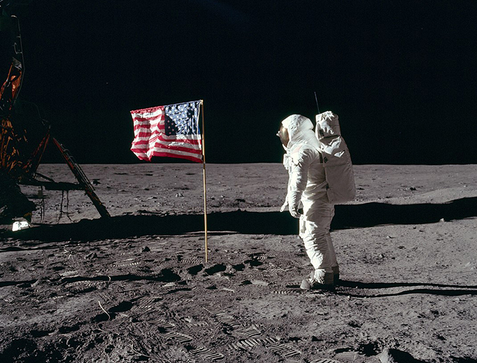 Buzz Aldrin salutes the U.S flag on the moon July 19, 1969. His fingertips are visible on the far side of his faceplate.