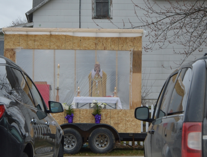 Father Michael Klos celebrates a drive-in Mass on Easter Sunday 2020 in the Sacred Heart Church parking lot in Cashton, Wisconsin.