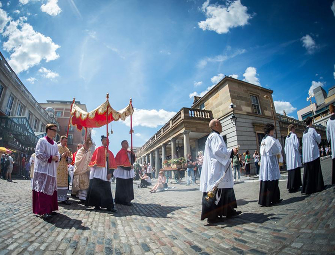 Holy Mass and Corpus Christi procession at historic church in London's Covent Garden area.