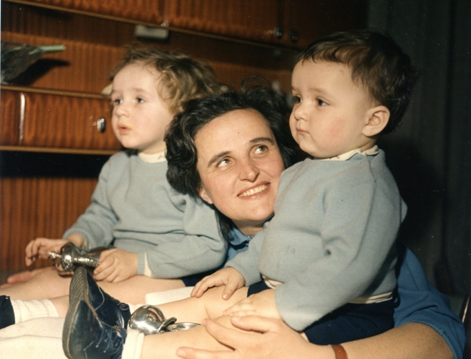St. Gianna, living holy the present moment, with two of her children.