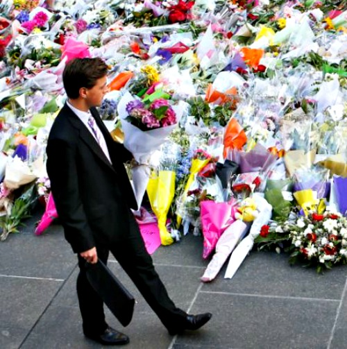 A man places flowers as a mark of respect for the victims of the Martin Place siege on Dec. 16 in Sydney.