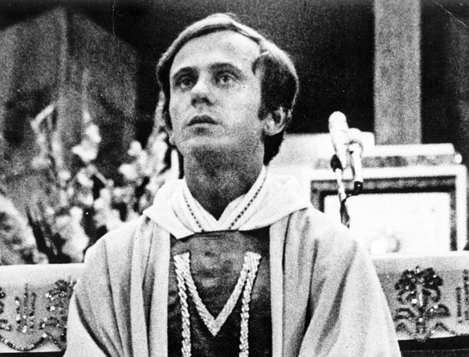 Blessed Jerzy Popiełuszko celebrates Mass in the 1980s; below, his grave is a place of pilgrimage.