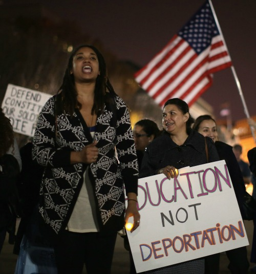 Demonstrators hold a vigil in support of immigrant children fleeing violence in Central America outside the White House on Nov. 24.